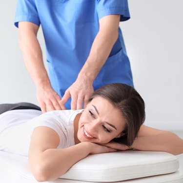 Image of woman getting adjustment.